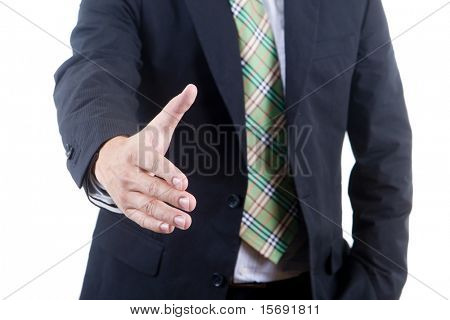 Business man reaching out to shake a hand