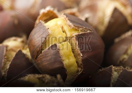 group of chestnuts on a wooden table