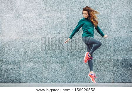 poster of Fitness sport girl in fashion sportswear doing yoga fitness exercise in the street, outdoor sports,