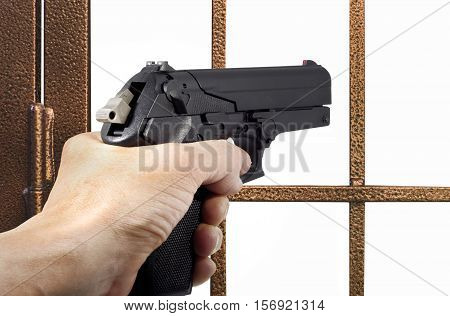 Thief armed with a pistol in front of a gate