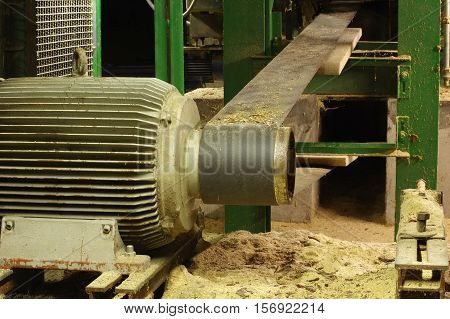Electric motor belt drive machine part sawmill wood industry theme.