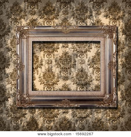 Grungy wallpaper with vintage gold frame