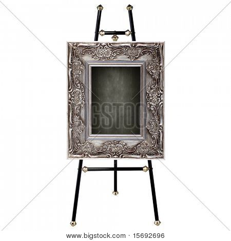 Easel with antique frame isolated on white