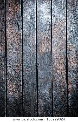 Closeup Of Burnt Black Wooden Table As Background