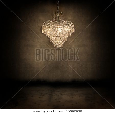 Crystal chandelier hanging in a dark grungy room