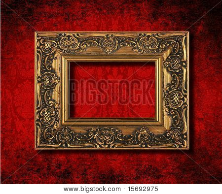Antique gold frame on a grungy Victorian velvet wallpaper background