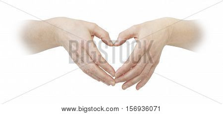 Making a heart with hands - female hands with thumbs and fingers touching making a heart shape on a white background