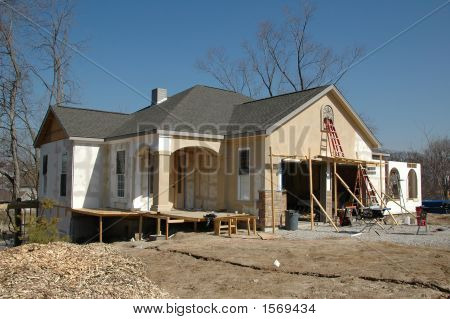 House Under Construction Against Blue Sky