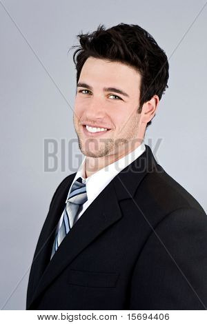 Attractive young smiling business man