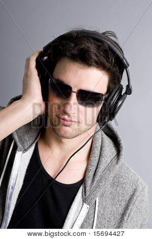 Dj listening to music on his headphones