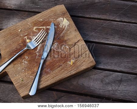 Empty plate with for remnants and dirty utensils