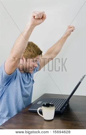 Enthusiastic man on his laptop