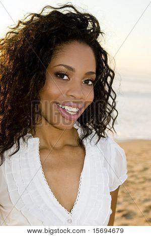 Beautiful woman on the beach at sunset