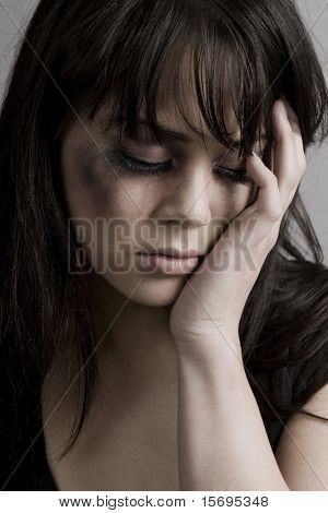 Abused woman crying holding her face