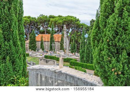 Virgin Mary old church on graveyard in Tucepi, Croatia.