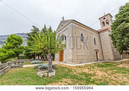 Church in old village of Tucepi on Makarska Riviera in Dalmatia, Croatia.