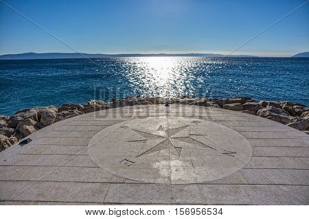 Beautiful stone compass on the Tucepi town beach.