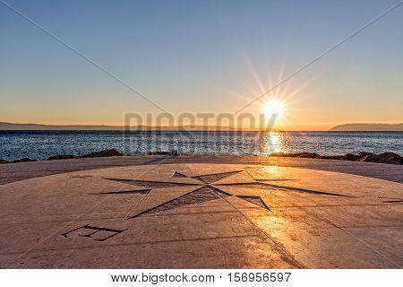 Beautiful sundown on the Tucepi town beach.