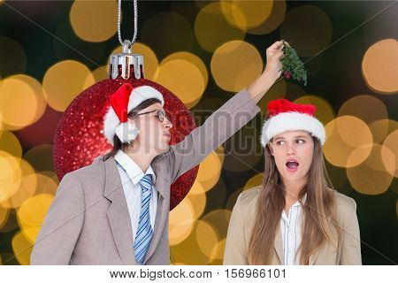 Couple having fun during christmas time against digitally generated background
