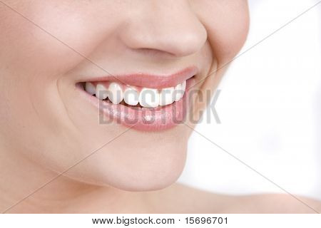 Clean, beautiful woman's smile isolated on white