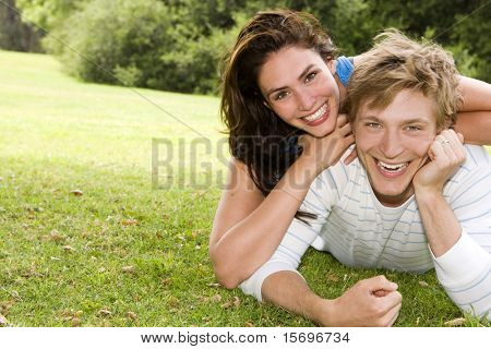 Loving young couple playing outside
