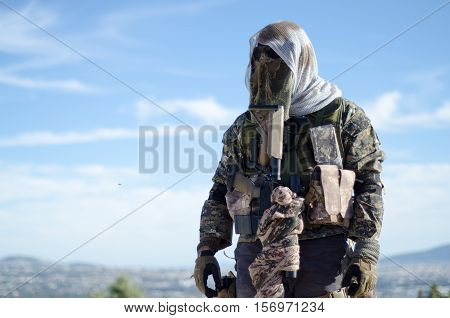 sniper stand up on roof and recon, target scope multicam ghillie suit