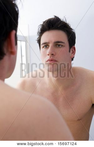 Man looking at his reflection