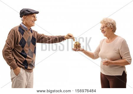 Mature man taking a cookie from a mature woman with a jar isolated on white background