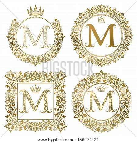 Golden letter M vintage monograms set. Heraldic coats of arms round and square frames.