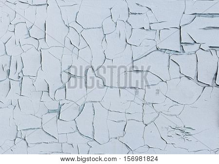 White wall with cracking paint background texture