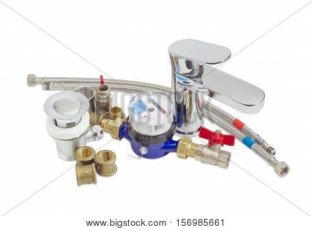 Single handle mixer tap water meter and some plumbing components on a light background