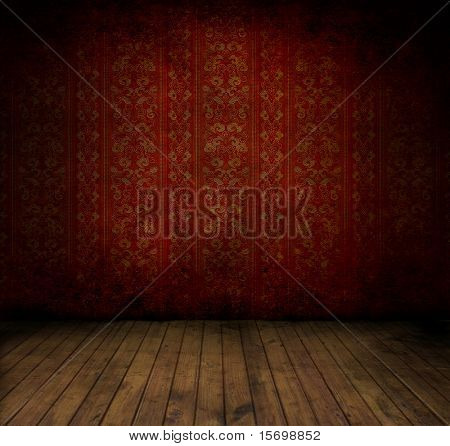 Empty old grungy room with red vintage wallpaper