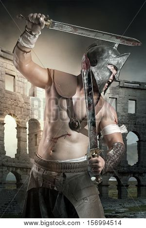 Gladiator with helmet posing ready to fight