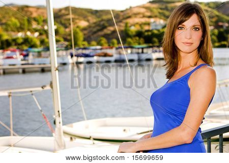 Pretty young woman at a harbor
