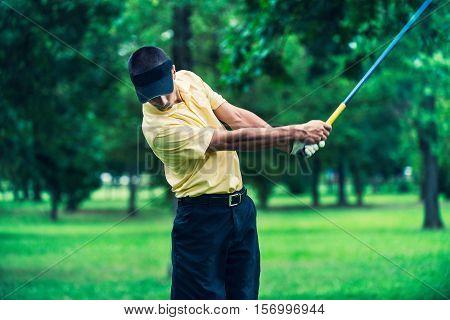Golfer teeing off, toned image, horizontal image