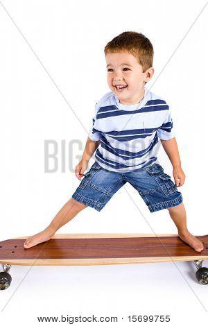 Cute little boy on a skateboard