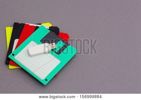 USB flash drive and some colored floppy disks
