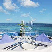 foto of buffet lunch  - Table setting at beach restaurant - JPG