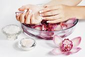 Spa and wellness details. Woman hands with manicured nails