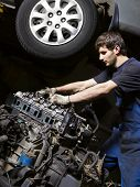 stock photo of internal combustion  - Auto mechanic checking an internal combustion engine - JPG