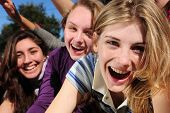 stock photo of reach the stars  - crowd of crazy teen girls celebrating a famous star on the red carpet - JPG