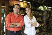 foto of business-partner  - proud family business partners owners of a small bookstore - JPG