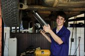 picture of car repair shop  - happy car mechanic working at the car  repair  shop - JPG