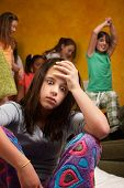 image of babysitting  - Overwhelmed and tired teen girl babysitting wild kids - JPG