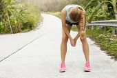 Tired Woman Runner Having Rest After Running Hard On Road In Forest, Bending Forward, Resting Elbows poster