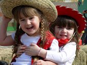 stock photo of hayride  - Little Cowgirls yeehawing at a preschool rodeo - JPG