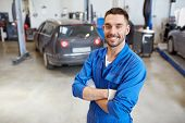 car service, repair, maintenance and people concept - happy smiling auto mechanic man or smith at wo poster