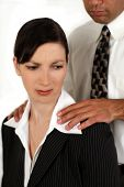 stock photo of inappropriate  - A man sexually harassing a coworker - JPG