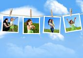 Family photographs hanging on a clothesline against a blue sky