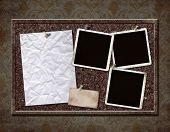 image of bulletin board  - Cork board with grungy blank photos and crinkled paper  - JPG